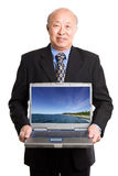 Senior asian businessman and laptop Stock Photography