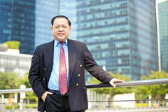 Senior Asian businessman smiling portrait Stock Photos