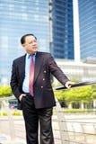 Senior Asian businessman smiling portrait Royalty Free Stock Photos
