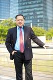 Senior Asian businessman smiling portrait Royalty Free Stock Photography