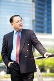 Senior Asian businessman smiling portrait Stock Image