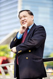 Senior Asian businessman smiling portrait Stock Photo