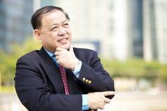 Senior Asian businessman smiling portrait Royalty Free Stock Images