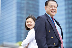 Senior Asian businessman and young female Asian executive smiling portrait. Outdoor Stock Photos