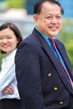 Senior Asian businessman and young female Asian executive smiling portrait. Outdoor Stock Image
