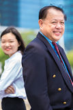 Senior Asian businessman and young female Asian executive smiling portrait. Outdoor Royalty Free Stock Photos