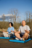 Senior asian couple exercise Stock Photos