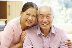 Senior Asian couple at home Stock Images
