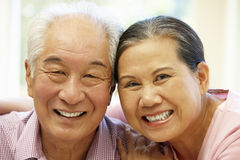 Senior Asian couple at home Stock Image