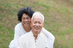 Senior Asian couple outdoor portrait. Royalty Free Stock Image