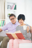 Senior asian couple reading a book Royalty Free Stock Photography