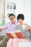 Senior asian couple reading a book Royalty Free Stock Photography