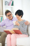 Senior asian couple reading a book Stock Photography