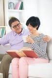 Senior asian couple reading a book Stock Photography