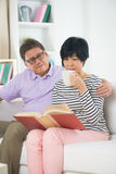 Senior asian couple reading a book Royalty Free Stock Image