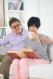 Senior asian couple reading a book Royalty Free Stock Image