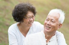 Senior Asian couple relaxing outdoor. Royalty Free Stock Photography