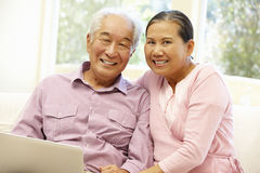Senior Asian couple using laptop Stock Photos