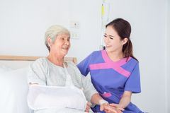 Senior asian female patient smiling with nurse Royalty Free Stock Image