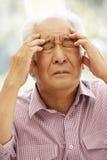 Senior Asian man with headache Stock Images