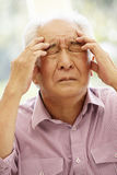 Senior Asian man with headache Royalty Free Stock Images
