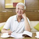 Senior asian man reading in study room Stock Photo