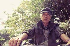Senior asian man riding his bicycle Stock Photo