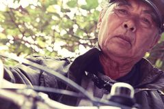 Senior asian man riding his bicycle Stock Photography