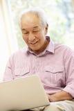 Senior Asian man using laptop Stock Photos