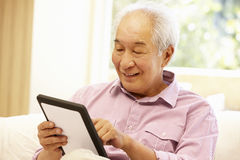 Senior Asian man using tablet Stock Image