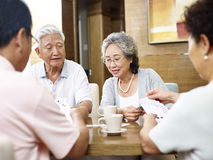 Senior asian people playing cards Royalty Free Stock Photos