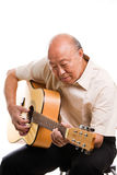 Senior Asian Playing Guitar Royalty Free Stock Photos