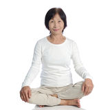 Senior asian woman doing meditation in buddhism pr. Actice against white background Royalty Free Stock Images