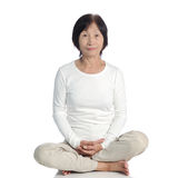 Senior asian woman doing meditation in buddhism practice Royalty Free Stock Images