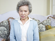 Senior asian woman. Portrait of an angry senior asian woman Royalty Free Stock Photography