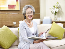 Senior asian woman reading a book Royalty Free Stock Photo