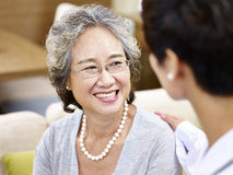 Senior asian woman talking to a doctor Stock Photography