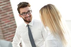 Senior assistant looks at the handshake business partners. Stock Images