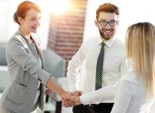 Senior assistant looks at the handshake business partners. The concept of partnership Stock Image
