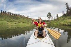 Senior athletic canoe paddler Royalty Free Stock Image