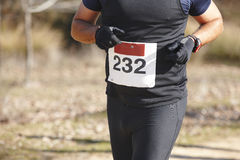Senior athletic runner on a cross country race. Outdoor circuit Stock Images