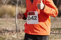Senior athletic runner on a cross country race. Outdoor circuit Stock Photos
