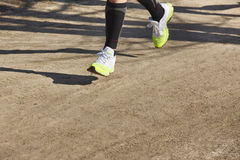 Senior athletic runner legs detail. Outdoor circuit Royalty Free Stock Photo