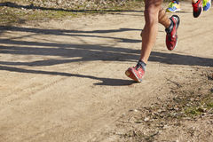 Senior athletic runner legs detail. Outdoor circuit Royalty Free Stock Image