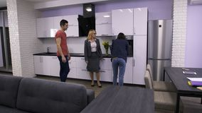 Female estate agent showing apartment to couple stock footage