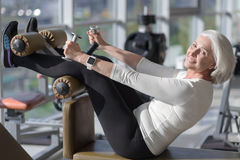 Senior attractive woman exercising. stock photography