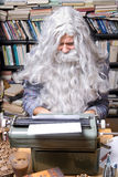 Senior author. Author working on a old typewriter stock photography