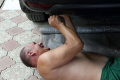 Senior auto mechanic installing hitch car Royalty Free Stock Photography