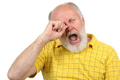Senior bald and bearded man is bored. And yawning Royalty Free Stock Photos