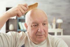 Senior bald man with comb Stock Photography